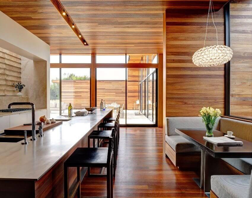 Горизонтальная укладка ламината на стену на кухне