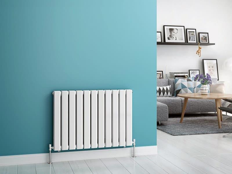 Биметаллической радиатор в дизайне комнаты